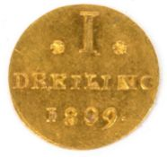 An early 19th century Hamburg 1 Dreiling gold pattern strike coin dated 1809, 0.9 grams in weight,