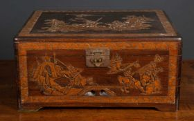 A mid to late 20th century Chinese carved hardwood cutlery box with a lifting lid and drawer