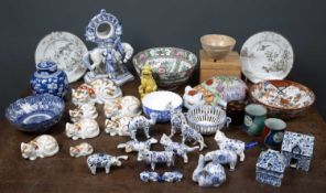A group of Japanese porcelain cats the largest approximately 24cm wide together with further