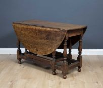 An 18th century oak drop leaf gateleg table 121cm wide x 72cm highCondition report: In good usable