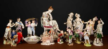 A collection of twenty six continental porcelain figurines to include Rudolstadt Volkstedt figural