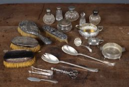 A mixed lot of silver and white metal to include silver backed brushes, three silver topped cut