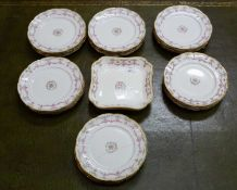 An early 20th century French porcelain part dinner service marked 'Toy 10 Rue de la Paix'Condition