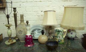 A studio pottery bowl 29cm diameter x 11cm high; an Islamic brass candlestick, 49cm high; three