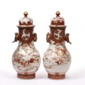 A large pair of late 19th / early 20th century Japanese kutani vases with covers and bird form