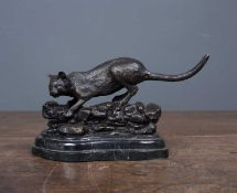 A bronze cat after Mene, late 20th century, 19cm wide x 10cm highCondition report: In good