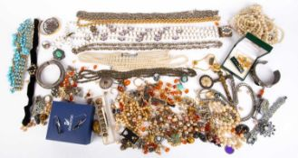 A collection of costume jewellery to include assorted necklaces, bracelets, brooches etcCondition
