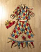 An early 20th century silk jesters outfit with a porcelain headed marotte, includes hat, jacket,