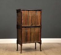 A small mahogany two tier bookcase together with The Encyclopedia Britannica 11th Edition, the