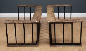 Two late 19th / early 20th century club fenders with oak tops and cast iron bases, 143cm wide x 61cm