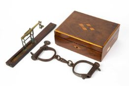 A pair of antique Hiatts iron cufflinks each 9cm wide includes one key together with a cased set