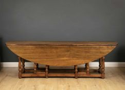 A 20th century drop leaf wake table with turned supports, 235cm in length x 51cm wide (flaps down) x