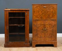 A Victorian walnut side cabinet with a brass galleried top and a single glazed door, raised on a
