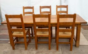 A modern oak dining table and six chairs, the table 220cm wide x 85cm deep x 76cm highCondition