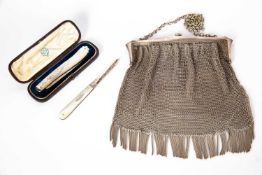 A silver mesh purse with marks for Birmingham 1916, approximately 240 grams; a Victorian silver