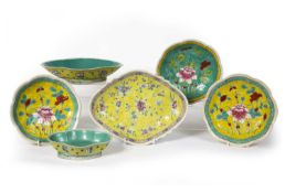 Straits yellow ground shaped dish Chinese, painted with flowers in polychrome enamels, 30cm across