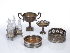 Collection of silver and silver-plated items to include: Three-piece glass cruet set on silver