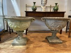 Pair of reconstituted urns of classical form, each on a pedestal base, 78cm at widest, 70cm high