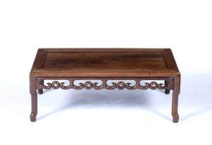 Hardwood low tableChinesecarved all around with cloud motifs to the rails, 27.5cm high, 75cm wide,