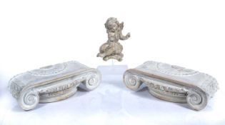 Pair of painted pine capitals Italian, 35cm x 13cm, and a similar painted pine putti, 20cm high