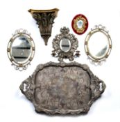 Collection of pieces including a large plated tray, 74cm across, a pair of brass mirrors, 40cm high,