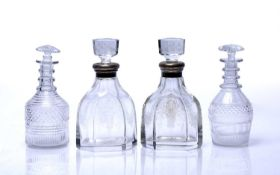 Pair of silver-mounted decanters each with etched panels of baskets of flowers, 24cm high and a pair