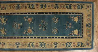 Chinese carpet (Runner) decorated with medallions, 340cm x 91cm approxCondition report: At