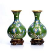 Pair of contemporary Chinese cloisonne enamel vases with bird amongst branches decoration on green
