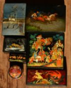 Collection of Russian lacquered boxes some signed of various shapes and measurements, one of a