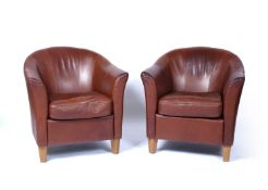 Pair of leather tub chairs each on short oak tapering supports, 76cm wide x 79cm highCondition