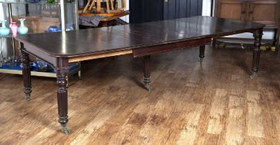 Mahogany Gillows style extending dining table on turned and reeded supports with original castors