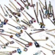 Large collection of 19th Century bone and wood lace bobbins of various designs and styles to include
