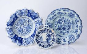 Two early Delftware lobed dishes and a miniature dish or stand, all circa 1680-1700, painted in blue
