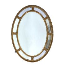 Oval plaster wall mirror circa 1900, with oval paterae to the border, 85cm x 63cmCondition report: