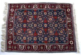 Eastern rug of blue ground with foliate designs and fringed edges, 165cm x 118cmCondition report: