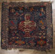 Caucasian blue ground rug with stylised geometric designs, and heraldic 'lion passant' panels to