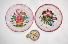 Two faience plates French circa 1820 and a little tas de vin, the plates decorated to the centre