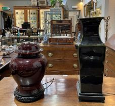 Two Chinese style table lamps each with a shade, 49.5cm high and 35cm high (excluding fittings)