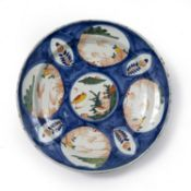 Polychrome Delftware charger possibly London ca.1730 with geometric leaf and flower decoration, 34.