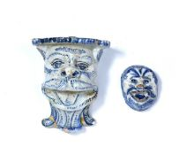 Two Delft blue and white glazed wall mounts/brackets 17th/18th Century, each modelled as a head, 8cm