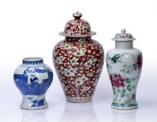 Three Chinese vases 19th Century, comprising of a coral red ground lidded vase decorated with