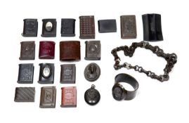 Collection of vulcanite to include seventeen vesta cases of varying styles and different motifs, a