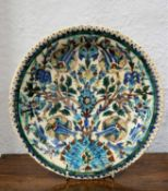 Iznik dish Persian, decorated in blue, turquoise, manganese, turquoise, green and black outline on a