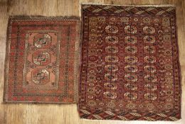 Turkoman red ground rug with elephant foot designs, 109cm x 132cm and a smaller similar rug, 94cm