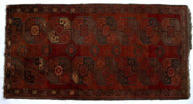Bokhara red ground rug Turkish, with elephant foot medallions, 210cm x 109cmCondition report: Some
