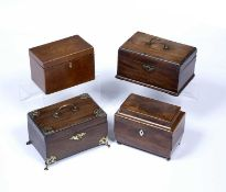 Group of four mahogany tea caddies 19th Century, one with brass mounts and handle, 23cm