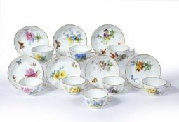 Set of eight Meissen coffee cups and seven saucers each painted with butterflies and individual