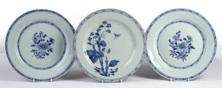 Three blue and white platesChinese, 18th/19th Century, comprising of a pair depicting a central