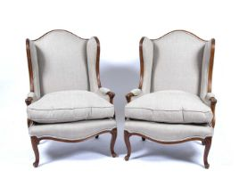 Pair of French style wing armchairs each with grey upholstery and matching loose squab cushions,