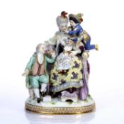 Meissen figure group 'The Good Mother' modelled as a mother sitting in an armchair with her three